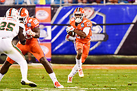 Charlotte, NC - DEC 2, 2017: Clemson Tigers running back Darien Rencher (21) runs for a big gain during ACC Championship game between Miami and Clemson at Bank of America Stadium Charlotte, North Carolina. (Photo by Phil Peters/Media Images International)