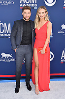 LAS VEGAS, CA - APRIL 07: Chris Lane (L) and Lauren Bushnell attend the 54th Academy Of Country Music Awards at MGM Grand Hotel &amp; Casino on April 07, 2019 in Las Vegas, Nevada.<br /> CAP/ROT/TM<br /> &copy;TM/ROT/Capital Pictures