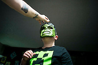 Autism for Joe<br /> Joe plays with an Incredible Hulk mask at home. His mother bought him the mask to help him understand the emotions of anger and aggression better.
