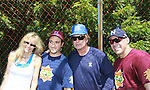 Alec Baldwin (The Doctors) and 30 Rock poses with Lori Singer (Footloose and Fame), Greg Bello, Jim Leyritz (former Yankee player) at the 63rd Annual Charity Softball Game 2011 - Artists versus Writers to benefit East Hampton Day Care Learning Center, East End Hospice and Phoenix Houses of Long Island - played at Herrick Park, East Hampton, New York. (Photo by Sue Coflin/Max Photos)