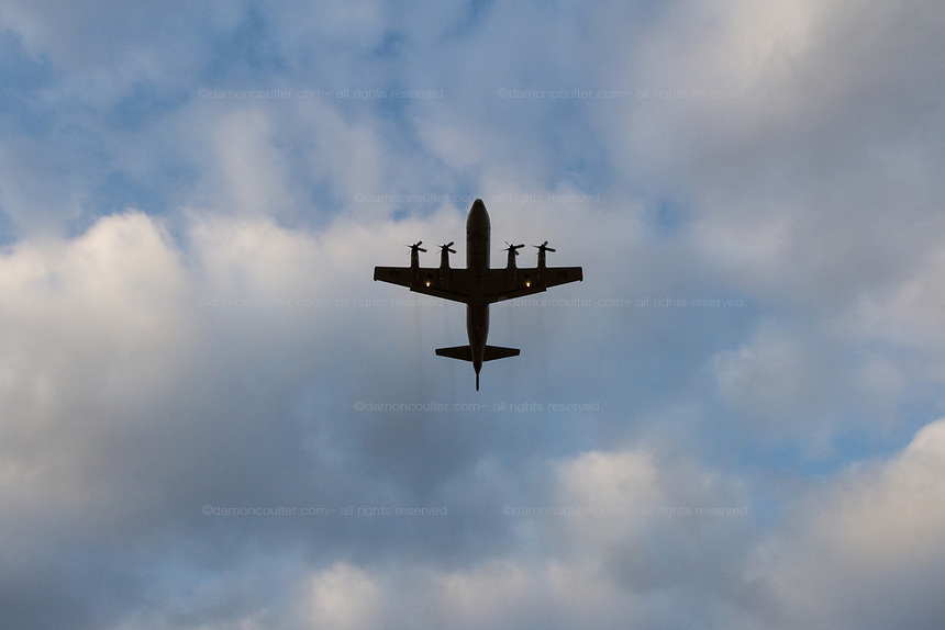 A Lockheed P-3C Orion Maritime reconnaissance aircraft with the Japanese Self Defence Force (JSDF) taking off from Naval Air Facility, Atsugi airbase near Yamato in Kanagawa, Japan, Wednesday February 13th 2019