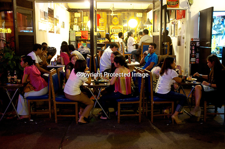 Customers seen enjoying a relaxed evening during an exhibition at the famous bar, Fred's Revolución in Manila Collective at Cubao Expo in Quezon city in Manila, Philippines. Photo: Sanjit Das