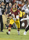 Washington Redskins quarterback Kirk Cousins (8) scrambles for a first down in the third quarter against the Oakland Raiders at FedEx Field in Landover, Maryland on Sunday, September 24, 2017.  The Redskins won the game 27-10.<br /> Credit: Ron Sachs / CNP