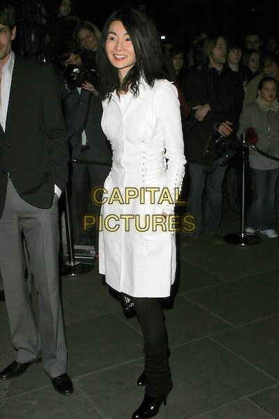 "MAGGIE CHEUNG.VIP private view of ""Vanity Fair Portraits"" sponsored by Burberry, National Portrait Gallery, London, England..February 11th, 2008.full length white coat straps hand in pocket.CAP/AH.©Adam Houghton/Capital Pictures."