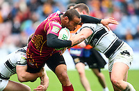 PICTURE BY VAUGHN RIDLEY/SWPIX.COM - Rugby League - Super League - Huddersfield Giants v Hull FC - Galpharm Stadium, Huddersfield, England - 09/04/12 - Huddersfield's Leroy Cudjoe is tackled by Hull FC's Kirk Yeaman and Jamie Ellis.
