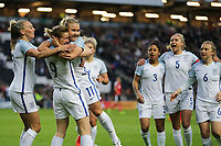 Ellen White of England Women (2nd left) celebrates with Isobel Christiansen (Manchester City) (3rd left) of England Women (right) after she scores the opening goal of the game during the Women's Friendly match between England Women and Austria Women at stadium:mk, Milton Keynes, England on 10 April 2017. Photo by PRiME Media Images / David Horn.