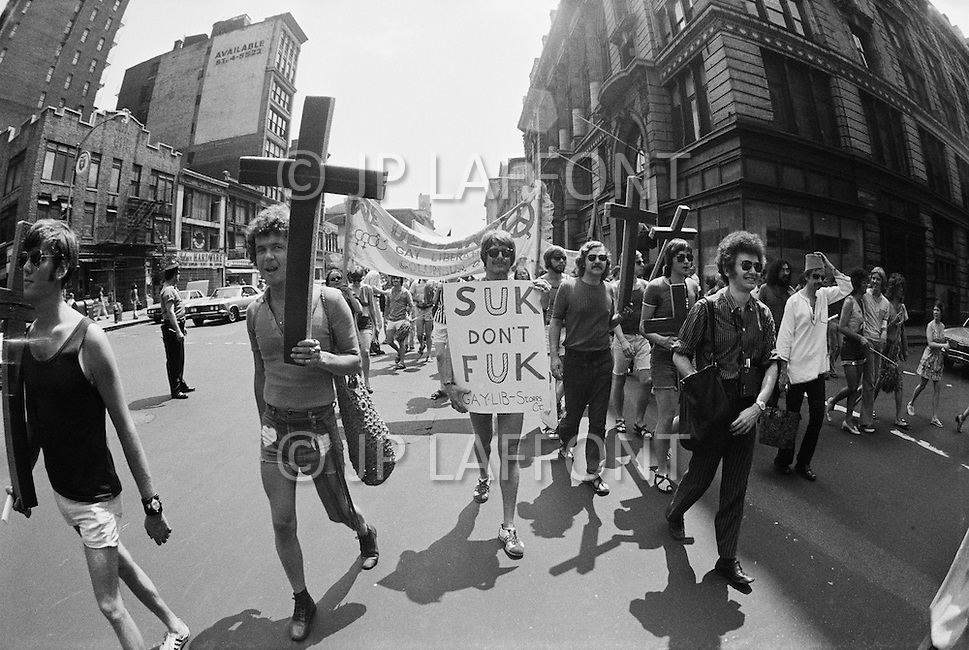 27 Jun 1971 --- Demonstrators carry signs and crosses during the second Gay Pride Parade in New York City. --- Image by © JP Laffont