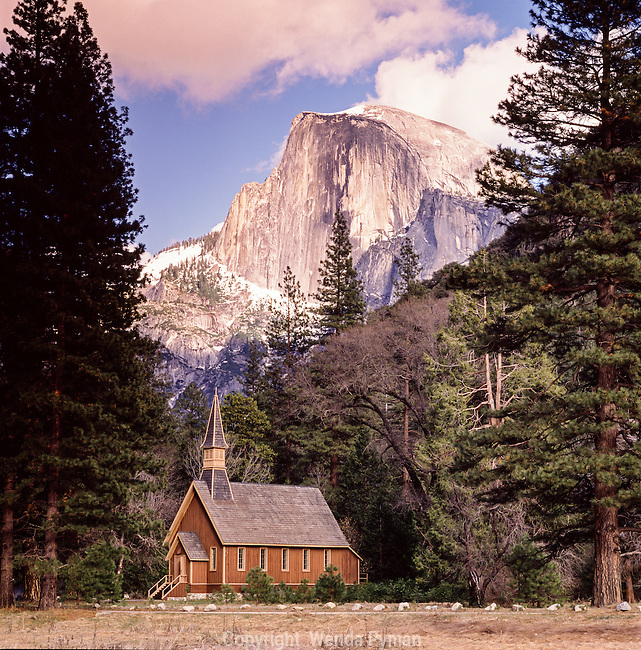 Half Dome lights up over the Yosemite Chapel after a clearing storm.