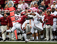 NWA Democrat-Gazette/CHARLIE KAIJO Arkansas Razorbacks D. Harris (0) runs Alabama Crimson Tide quarterback Tua Tagovailoa (13) out of bounds during the second quarter of a football game, Saturday, October 6, 2018 at Donald W. Reynolds Razorback Stadium in Fayetteville.