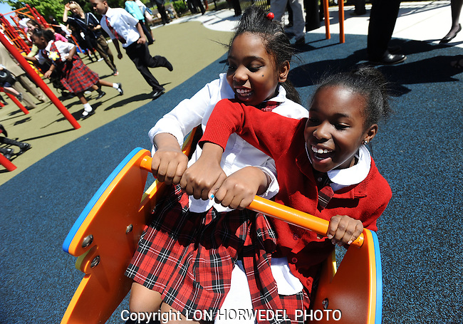 Pictures of the year 2012:  A pair of young girls having fun on the new playground structure during the River Front Play Park Grand Opening in downtown Detroit, Thursday, May 10.