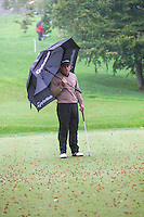 THOMASTOWN, IRELAND. Paul McGinlye from IRL shelters from the rain during the American Express Championship day two at the Mount Juliet Golf Club on October 1th, 2004 in Thomastown, Ireland ..Photo AFP/NEWSFILE/EOIN CLARKE..(Photo credit should read Eoin Clarke/NEWSFILE/AFP)...This Picture has been sent you under the condtions enclosed by:.Newsfile Ltd..the Studio,.Millmount Abbey,.Drogheda,.Co Meath..Ireland..Tel: +353(0)41-9871240.Fax: +353(0)41-9871260.GSM: +353(0)86-2500958.email: pictures@newsfile.ie.www.newsfile.ie.FTP: 193.120.102.198..This picture is from Fran Caffrey@newsfile.ie