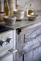 The cupboard doors in the kitchen have been constructed from antique wood panels