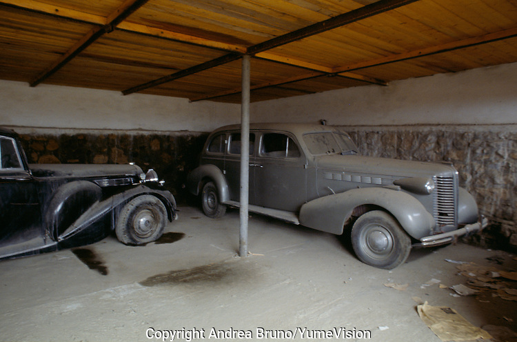 A Daimler DE36 on the left and a Packard Twelve on the right in the bunker build by UNESCO in the courtyard of the Afghan Kabul National museum in 1991