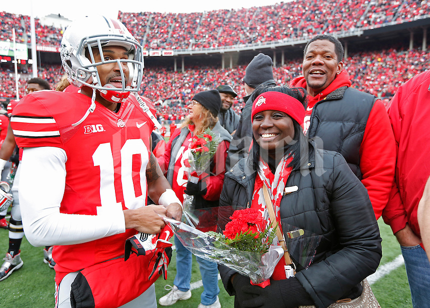 Ohio State Buckeyes wide receiver Philly Brown (10) greets family during Senior Day celebration before the college football game between the Ohio State Buckeyes and the Indiana Hoosiers at Ohio Stadium in Columbus, Saturday afternoon, November 23, 2013. The Ohio State Buckeyes defeated the Indiana Hoosiers 42 - 14. (The Columbus Dispatch / Eamon Queeney)