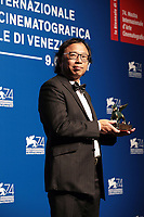 VENICE, ITALY - SEPTEMBER 09: Hsin-Chien Huang poses with the Best VR Experience Award for 'La Camera Insabbiata' co-directed with Laurie Anderson at the Award Winners photocall during the 74th Venice Film Festival at Sala Casino on September 9, 2017 in Venice, Italy.  ()<br /> CAP/MPI/AF<br /> &copy;AF/MPI/Capital Pictures