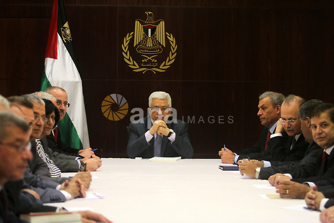 Palestinian president Mahmud Abbas chairs a cabinet session in the West Bank city of Ramallah on July 28, 2013. Israeli Prime Minister Benjamin Netanyahu was seeking cabinet approval for a contentious release of 104 veteran Palestinian and Israeli-Arab prisoners, to coincide with the resumption of peace talks which have been stalled since September 2010. Photo by Issam Rimawi / POOL
