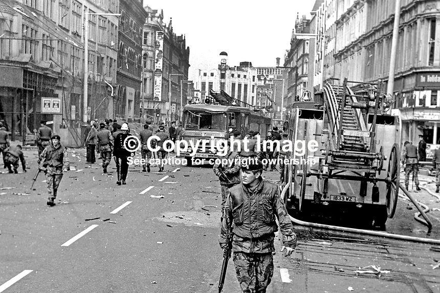 British soldiers seal off Royal Avenue, Belfast, N Ireland, following an explosion outside the former Grand Central Hotel in March 1974. The hotel  became even more of a target after it was taken over by the British Army as as a base and billet. 197403000216c..© Victor Patterson, 54 Dorchester Park, Belfast, N Ireland. Tel: +44 2890661296; Mobile: +44 7802 353836; Emails: victorpatterson@me.com & victorpatterson@gmail.com; www.victorpatterson.com