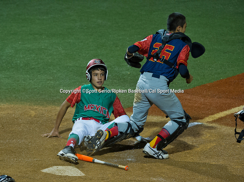 August 15, 2014: Runner from Mexico is tagged out during a run for home against Japan during the Cal Ripken 12u 70-foot World Series United States Championship at the Ripken Experience powered by Under Armour in Aberdeen, Maryland on August 15, 2014, Mexico won 10-7.Scott Serio/Ripken Baseball/CSM