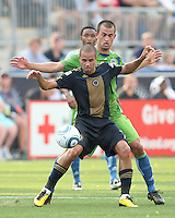 Fred #7 of the Philadelphia Union holds off Patrick Ianni #4 of the Seattle Sounders FC during the first MLS match at PPL stadium in Chester, PA. on June 27 2010. Union won 3-1.