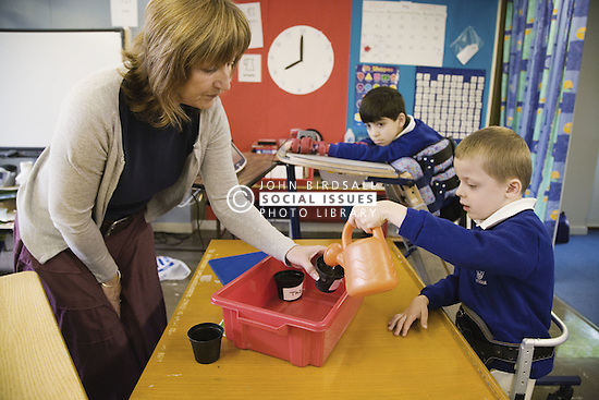 Physically disabled child working with a speech and language therapist,