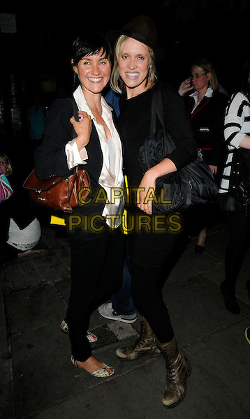"ESTHER HALL & BETH CORDINGLY.The ""Ghost Stories"" VIP evening, Duke of York's Theatre, London, England..July 14th, 2010.full length black leggings op dress brown boots hat fedora trilby bag purse silk satin blouse white  .CAP/CAN.©Can Nguyen/Capital Pictures."