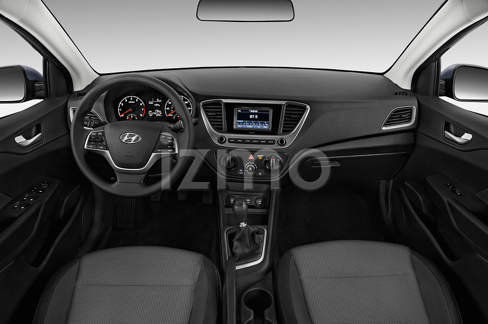 Stock photo of straight dashboard view of a 2018 Hyundai Accent SE 4 Door Sedan