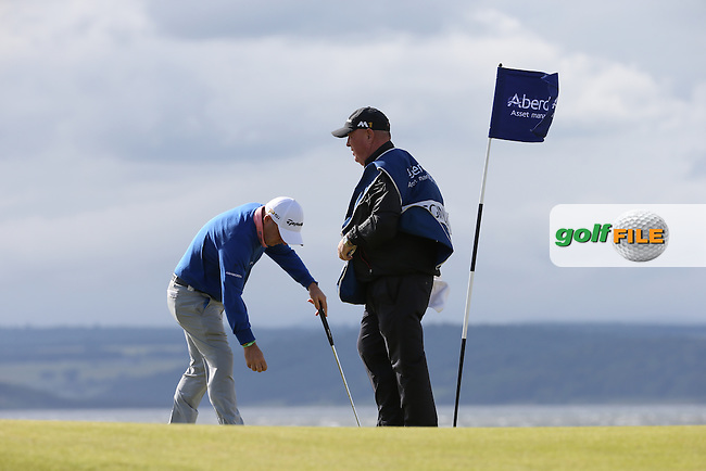 Paul McGinley (IRL) and caddie Jimmy Rae on the 3rd during Round One of the 2016 Aberdeen Asset Management Scottish Open, played at Castle Stuart Golf Club, Inverness, Scotland. 07/07/2016. Picture: David Lloyd | Golffile.<br /> <br /> All photos usage must carry mandatory copyright credit (&copy; Golffile | David Lloyd)