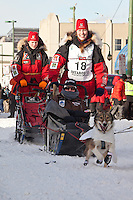 Musher Aliy Zirkle and Iditarider Debbie Woodall.leave the 2011 Iditarod ceremonial start line in downtown Anchorage, Alaska