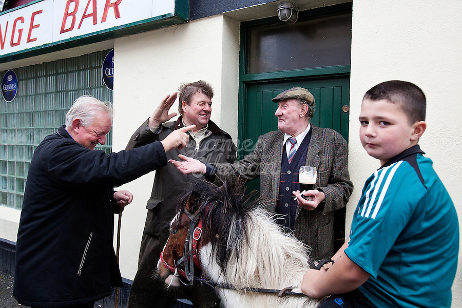 4/10/2010. Horse dealer's John White from Galway,Matt Walsh from Clare, Tommy Cullanan from Ennis and 9 year old Dany O Shea from Cork are pictured with Sam the pony outside the Emerald bar at the Ballinasloe Horse Fair, Ballinasloe, County Galway, Ireland. Picture James Horan