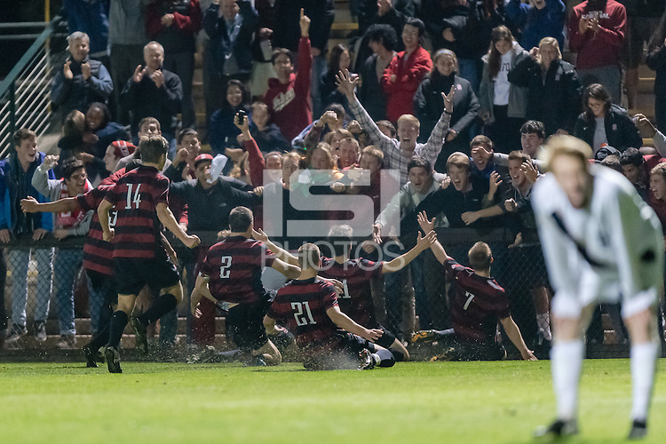 November 13, 2013: The team and fans celebrate Aaron Kovar's game winning goal in overtime during the Stanford vs Cal men's soccer match in Stanford, California.  Stanford won 2-1 in overtime.