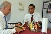 Arlington, VA - May 5, 2009 -- United States President Barack Obama and Vice President Joe Biden receive their cheese burger lunch orders at Ray's Hell Burger in Arlington, Virginia, on May 5, 2009..Credit: Roger L. Wollenberg - Pool via CNP