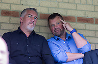 Celebrity Chef Paul Hollywood (left) of The Great British Bake Off sits in the stands alongside Wycombe Wanderers Chairman Andrew Howard of Beechdean Ice Cream during the Sky Bet League 2 match between Wycombe Wanderers and Hartlepool United at Adams Park, High Wycombe, England on 5 September 2015. Photo by Andy Rowland.