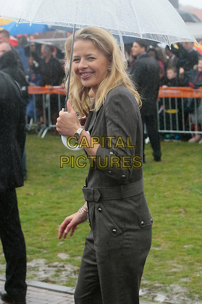 MABEL WISSE SMIT.Queen's Day in Holland 2010 is celebrated in Middelburg, Holland, The Netherlands, April 30th 2010..royal half length raining umbrella Dutch smiling grey gray jumpsuit catsuit side .CAP/IMS/EJ.©EJ/IMS/Capital Pictures