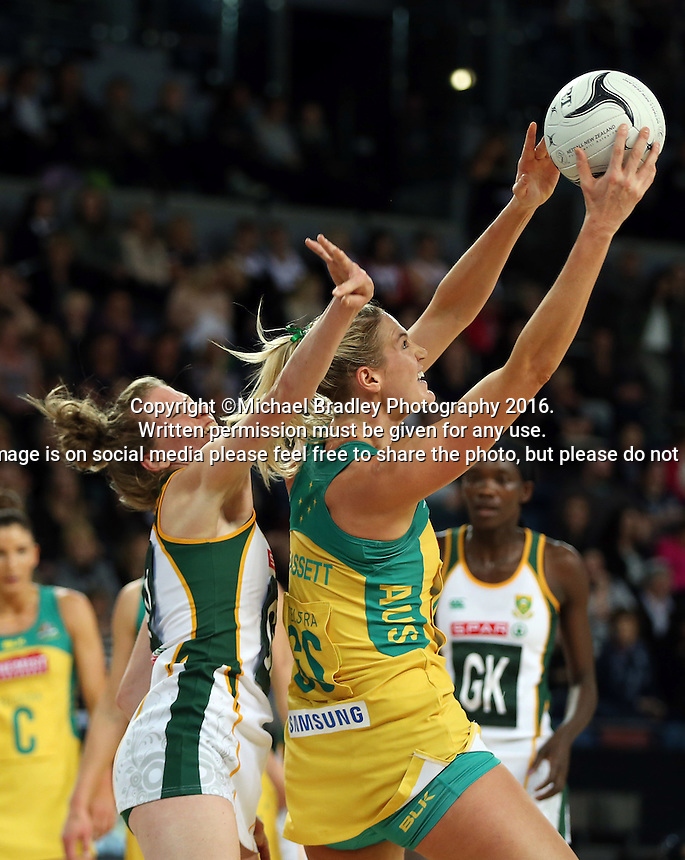 27.08.2016 South Africa's South Africa's Karla Mostert and Australia's Caitlin Bassett in action during the Netball Quad Series match between South Africa and Australia at Vector Arena in Auckland. Mandatory Photo Credit ©Michael Bradley.