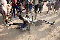Young boys from Panyok performing educational excercises, helping with teamwork, HIV/AIDS and other issues. This particular routine originated from the civil war, and is about helping the wounded and is part of the Twic Olympics in Wunrok, Southern Sudan.