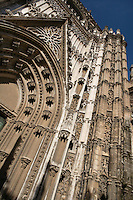 An oblique low angle view of the Puerta de San Cristobal or del Principe, Seville Cathedral, Andalucia, Spain, pictured on January 3 2007, in the winter afternoon light. Seville Cathedral is the largest Gothic building in the world. It was converted from the original 12th century Almohad Mosque on this site during the 16th century and the original Moorish entrance court and Giralda Minaret are both integrated in the cathedral. Inside is the tomb of the explorer Christopher Columbus (1451-1506). Picture by Manuel Cohen