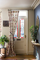 In the entrance hall the stained glass panels of the door are typically Victorian whilst the floral door curtain is a contemporary take of the Victorian original