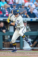 Michigan Wolverines third baseman Blake Nelson (10) at bat against the Vanderbilt Commodores during Game 1 of the NCAA College World Series Finals on June 24, 2019 at TD Ameritrade Park in Omaha, Nebraska. Michigan defeated Vanderbilt 7-4. (Andrew Woolley/Four Seam Images)