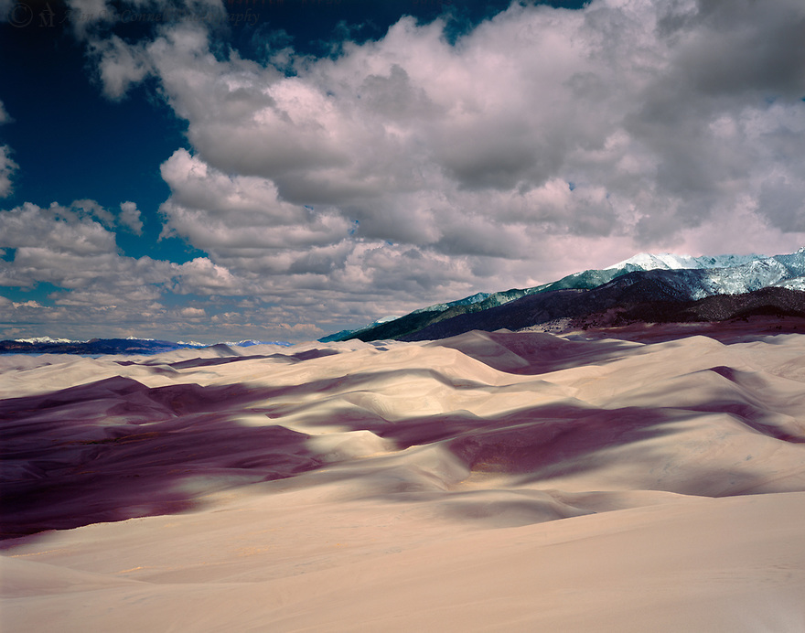Waves of dunes, along with the shadows, produce a view that is an interesting study of abstraction.