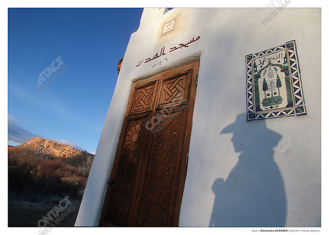 "19-year old, Fatimah Van HattumÕs shadow at dawn on the ""little family mosque"" her dad Benyamin built; near Abiquiu, New Mexico, December 2002"