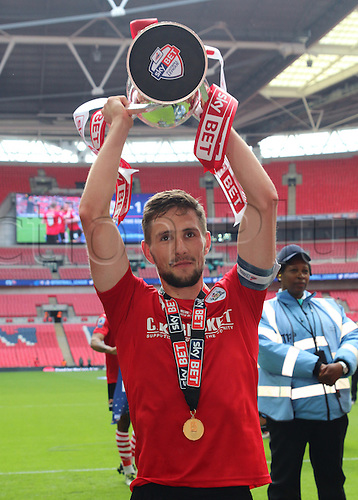 29.05.2016. Wembley Stadium, London, England. Skybet League One Play Off Final. Barnsley versus Millwall. Barnsley FC captain Conor Hourihane lifts the trophy