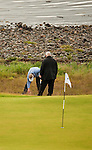 Colin Montgomerie marks his ball watched by Chief Referee John Paramor during the second round  of the Barclays Scottish Open, played over the links at Castle Stuart, Inverness, Scotland from 7th to 10th July 2011:  Picture Stuart Adams /www.golffile.ie 9th July 2011