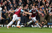 Pictured: Kevin Nolan of West Ham (R) celebrating his second goal with team mate James Collins (L). 01 February 2014<br />