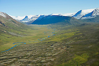Kolbeinsdalur valley viewing east: Saurbaer, Unastadir, Skriduland, Bjarnastadir all on the northern slopes and Fjall underneath the mountain in the midst of the valley. Sveitarfelagid Skagafjordur former Holahreppur.