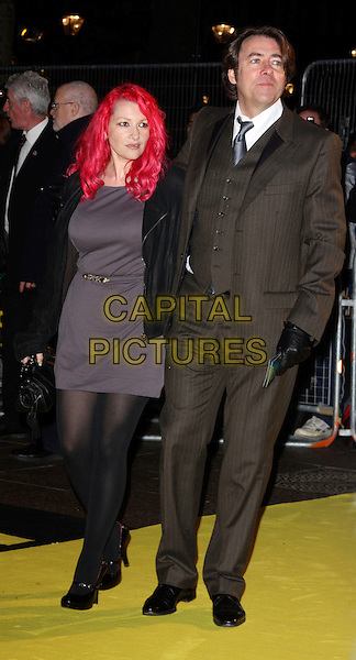 "JANE GOLDMAN & JONATHAN ROSS.The world premiere of ""Watchmen"" Odeon Leicester Square, London, England..February 23rd, 2009.full length black coat jacket brown suit waistcoat grey gray dress married husband wife gloves black .CAP/ROS.©Steve Ross/Capital Pictures."