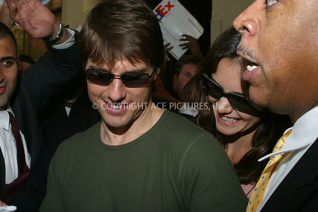 WWW.ACEPIXS.COM . . . . .  ....New York, June 22 2005....Amid a throng of fans and photographers Tom Cruise and Katie Holmes went to CBS studios and then arrived back at their midtown hotel following a 'War of the Worlds' press conference. Despite the best efforts of the heavy security team, Cruise and Holmes were brought to a standstill. Cruise signed autographs and Holmes clung onto him, but both seemed to enjoy the experience. ....Please byline: PAUL CUNNINGHAM - ACE PICTURES..... *** ***..Ace Pictures, Inc:  ..Craig Ashby (212) 243-8787..e-mail: picturedesk@acepixs.com..web: http://www.acepixs.com