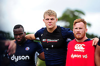 Tom Ellis of Bath Rugby looks on in a huddle. Bath Rugby pre-season training session on August 9, 2016 at Farleigh House in Bath, England. Photo by: Patrick Khachfe / Onside Images
