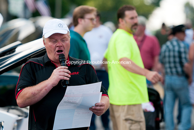 TORRINGTON, CT-062714JS01--Event emcee Glen Royals addresses the crowd during the annual D.A.R.E. Car Show in downtown Torrington on Friday night. The event helps pay for the supplies for the D.A.R.E. program in the Torrington Schools. <br /> Jim Shannon Republican-American