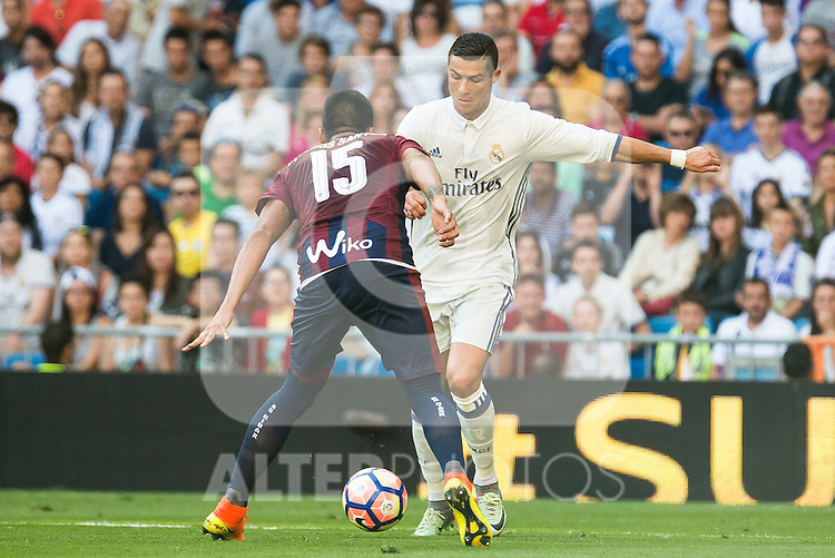 Real Madrid's player Cristiano Ronaldo and Eibar FC's player Mauro Dos Santos during a match of La Liga Santander at Santiago Bernabeu Stadium in Madrid. October 02, Spain. 2016. (ALTERPHOTOS/BorjaB.Hojas)