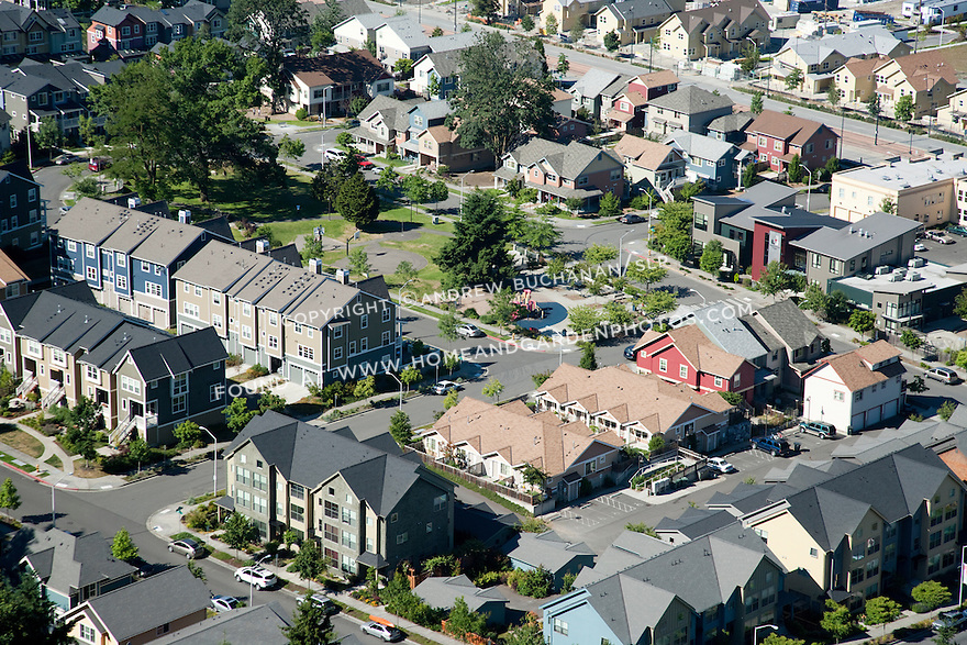 An aerial view of community park, businesses and housing in Rainier Vista, a mixed housing development in Seattle, WA.